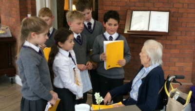 Year 5 talk to evacuees at the Home of Compassion