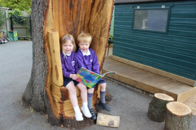 Pupils enjoy newly-carved Storyteller's Tree